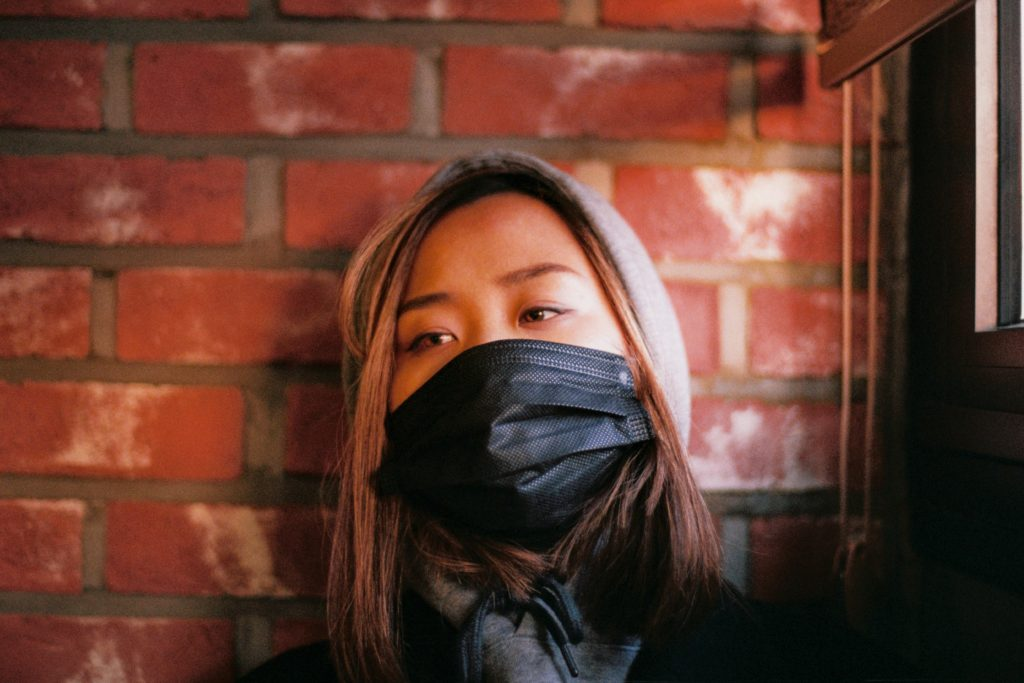 Woman in black face mask. Photo by Portuguese Gravity on Unsplash