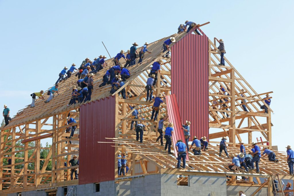 image of many builders on site